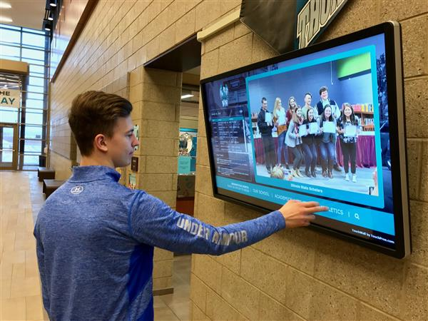 Photo of student using touchscreen